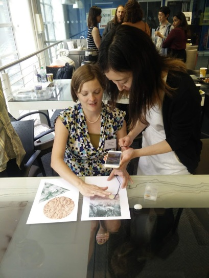 Designer Ryo Tada demoes 'Fulu', her haptic fingernail device to the IN-TOUCH team. Image credit: IN-TOUCH